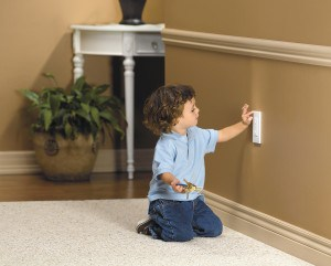 child playing with an outlet
